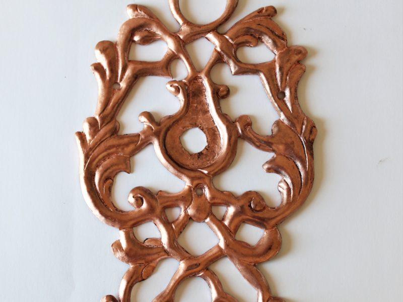 Treibarbeit aus Kupfer, Türrosette